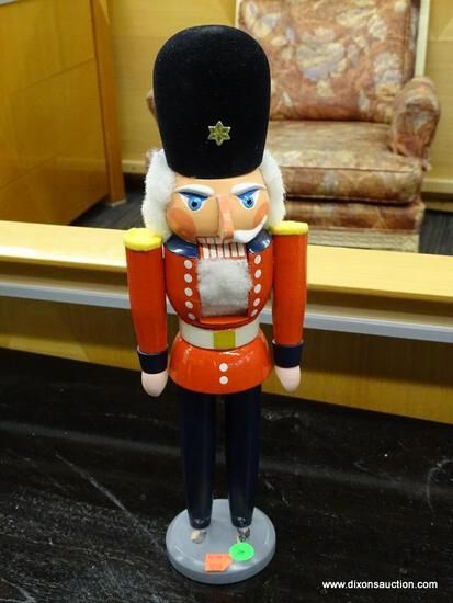 NUTCRACKER; NUTCRACKER OF A SOLDIER WITH RED UNIFORM AND TALL BLACK HAT. HAS SEEN SOME WEAR