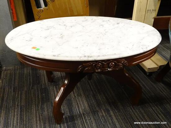 VICTORIAN MARBLE TOP COFFEE TABLE; HAS A WHITE MARBLE TOP AND MAHOGANY BONES WITH FLORAL CARVED