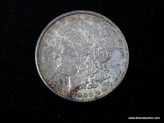 1900-P GEM BU TONED MORGAN SILVER DOLLAR.