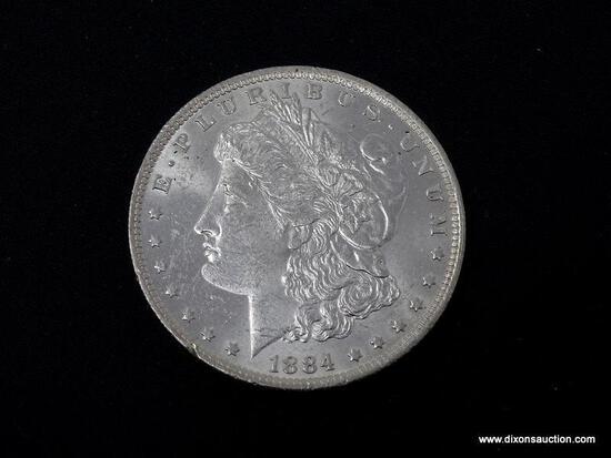 1884-O UNCIRCULATED MORGAN SILVER DOLLAR.