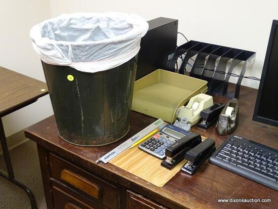 (RM2) COTENTS OF DESKTOP. INCLUDES: VINTAGE METAL TRASHCAN, 3 STAPLERS, 2 TAPE DISPENSERS, AND A