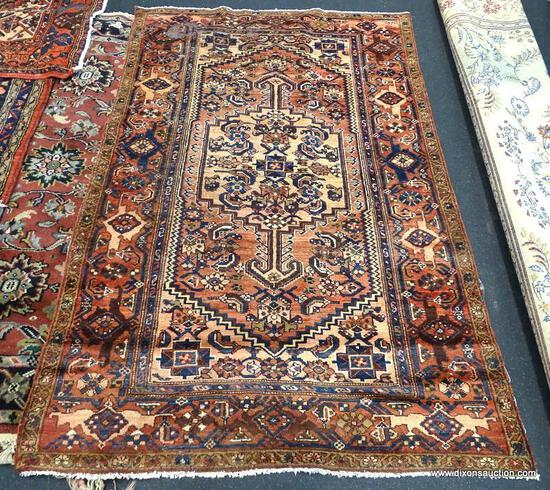 "IRAN ZANJAN RUG. MEASURES 4'1"" X 6'3"". MOTH WEAR IN CORNER."
