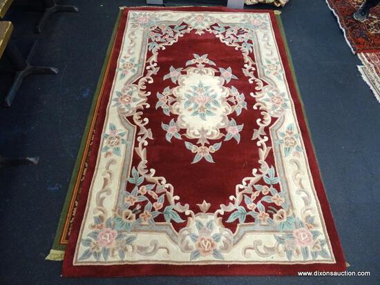 "CHINA TUFTED RUG. MEASURES 5' X 7' 11""."