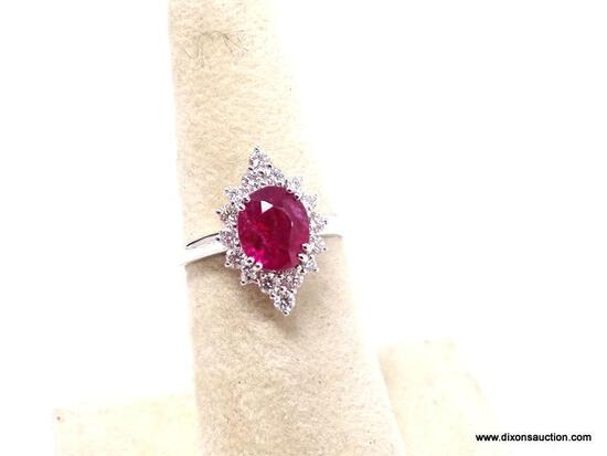 18K WHITE GOLD RUBY & DIAMOND RING. THE RING IS MOUNTED WITH 1 GENUINE NATURAL RUBY CENTER STONE