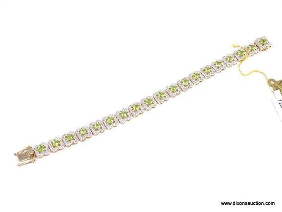 .925 SILVER PERIDOT & WHITE TOPAZ BRACELET WITH YELLOW GOLD OVERLAY. 19 SQUARE PERIDOT APPROX.