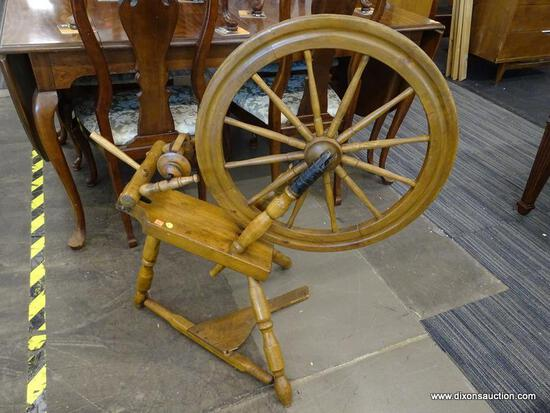 SPINNING WHEEL WITH 3 LEGGED BASE. APPEARS TO BE COMPLETE. MEASURES 36 IN X 22 IN X 38 IN. DOES NEED