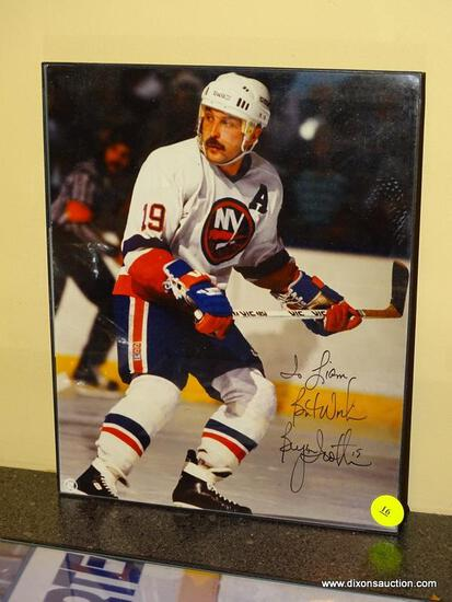 (BAS) FRAMED AND AUTOGRAPHED PHOTO OF BRYAN TROTTIER. IS IN A BLACK FRAME AND MEASURES 8.25 IN X
