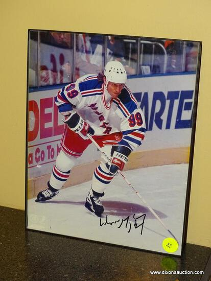 (BAS) FRAMED AND AUTOGRAPHED PHOTO OF WAYNE GRETZKY. IS IN A BLACK FRAME AND MEASURES 8.25 IN X