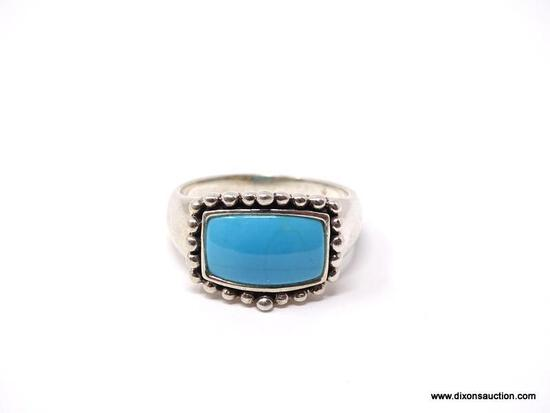 .925 STERLING SILVER & TURQUOISE RING WITH BEADED BORDER. WEIGHS APPROX. 6.20 GRAMS. RING SIZE IS 9.