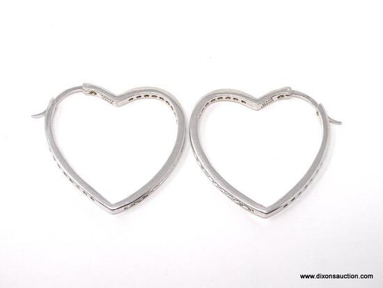 PAIR OF .925 STERLING SILVER HEART SHAPED PIERCED EARRINGS WITH CZ STONES DOWN THE SIDE. WEIGHS