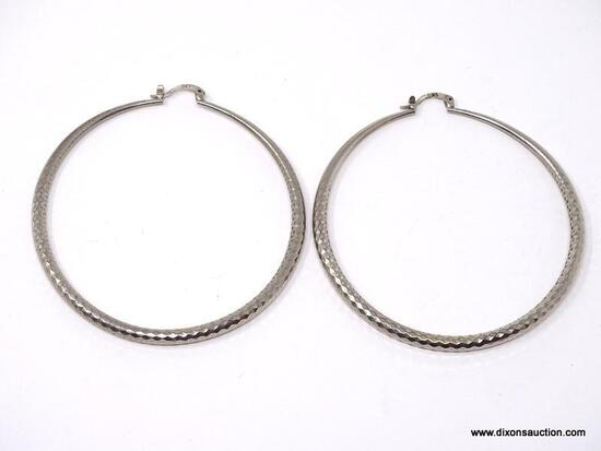 """LARGE PAIR OF HAMMERED .925 STERLING SILVER HOOP EARRINGS. MARKED ON THE CLASP """"925"""". THEY WEIGH"""