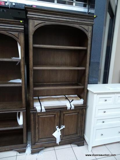 ARCADIA LIGHTED DOOR BOOKCASE WITH 3 GLASS SHELVES. QUALITY AND WORLD CLASS CRAFTSMANSHIP WAS AT THE