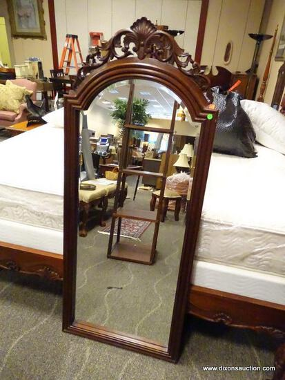 HIGHLY CARVED SOLID MAHOGANY FRAMED WALL MIRROR WITH BEVELED GLASS EDGE. MEASURES 26.5 IN X 63.5 IN.