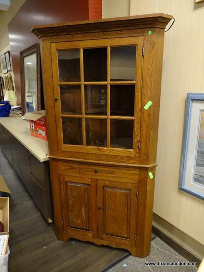 VINTAGE 2 PIECE OAK CORNER CABINET WITH CROWN MOLDING, 9 PANELED AREAS ON THE DOOR (7 HAVE GLASS