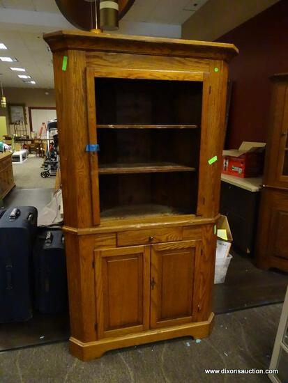 ANTIQUE OAK 2 PIECE CORNER CABINET WITH 2 INTERIOR WOODEN SHELVES, A SINGLE CENTER DRAWER, AND 2