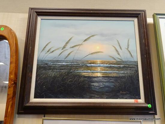 FRAMED OIL ON CANVAS OF A BEACH SUNSET WITH THE TIDES ROLLING AGAINST THE BEACH. IS IN A MAHOGANY
