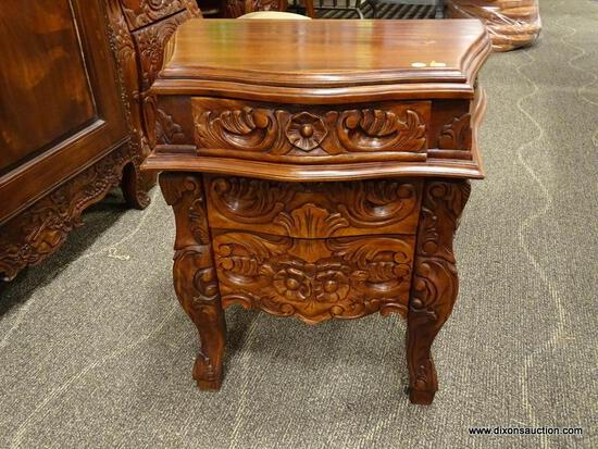 SOLID MAHOGANY HIGHLY CARVED 3 DRAWER NIGHTSTAND. IS 1 OF A PAIR. MEASURES 24 IN X 17 IN X 27 IN.