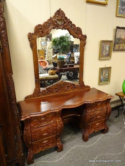 SOLID MAHOGANY HIGHLY CARVED 6 DRAWER VANITY WITH MIRROR. MEASURES 58 IN X 19 IN X 77.5 IN. ITEM IS