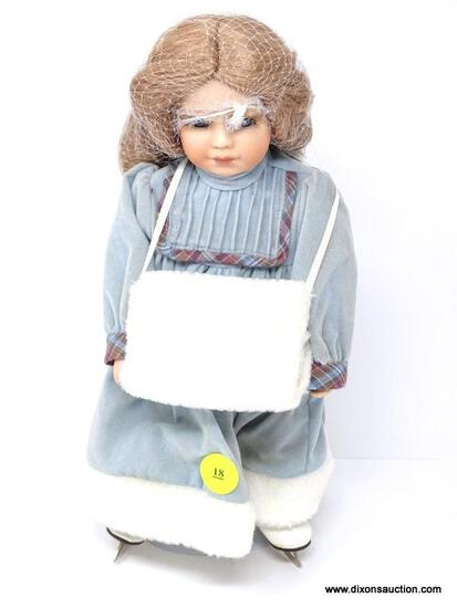 VINTAGE PORCELAIN DOLL IN THE FORM OF AN ICE SKATER WITH HAND WARMER. HAS STAND AND MEASURES 11 IN