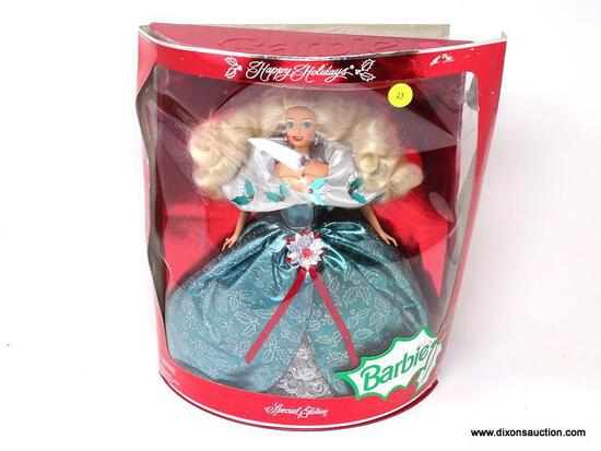 SPECIAL EDITION HAPPY HOLIDAYS BARBIE IN PACKAGE. IS IN A BLUE AND SILVER HOLLY THEMED DRESS AND IN