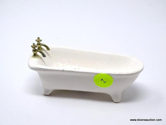 SMALL PORCELAIN DOLL BATHTUB. MEASURES 5 IN X 2 IN X 2 IN. ITEM IS SOLD AS IS WHERE IS WITH NO