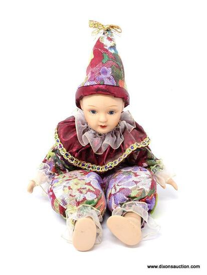 VINTAGE PORCELAIN AND CLOTH JESTER STYLE DOLL. MEASURES 5.5 IN TALL. ITEM IS SOLD AS IS WHERE IS
