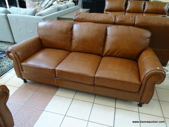 BRAND NEW ABBYSON TOP GRAIN LEATHER 3 CUSHION SOFA WITH BRASS STUDDED ACCENTS AND ROLLED ARMS.