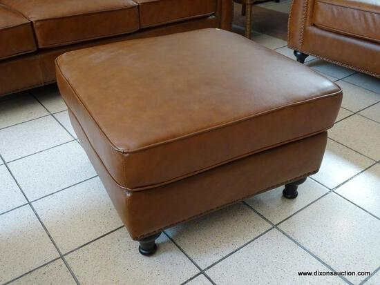 BRAND NEW ABBYSON TOP GRAIN LEATHER OTTOMAN WITH BRASS STUDDED ACCENTS AROUND THE EDGES. MEASURES 29