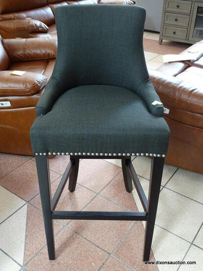 BRAND NEW GRAY UPHOLSTERED BAR CHAIR WITH SILVER TONE STUDDING AROUND THE EDGES. MEASURES 20 IN X 21