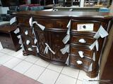 BRAND NEW DOOR DRESSER WITH SCROLL CARVINGS FROM THE ROYALE COLLECTION BY STEVE SILVER. THIS