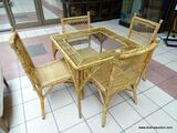 WICKER AND RATTAN PATIO TABLE SET WITH GLASS INSERT TOP ON THE TABLE. CHAIRS MEASURE 17 IN X 21 IN X