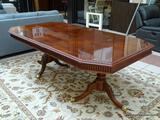 MAHOGANY DOUBLE PEDESTAL DINING TABLE WITH BRASS CAPPED FEET AND TWO 15.5 IN LEAVES. WITH BOTH