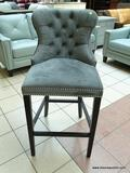 VELVET UPHOLSTERED BAR CHAIR WITH BUTTON TUFTED BACK AND SILVER TONED STUDDING AROUND THE EDGE.