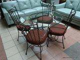 HEAVY WROUGHT IRON AND GLASS TOP DINETTE TABLE WITH 4 MATCHING CHAIRS WITH RED AND GOLD STRIPE