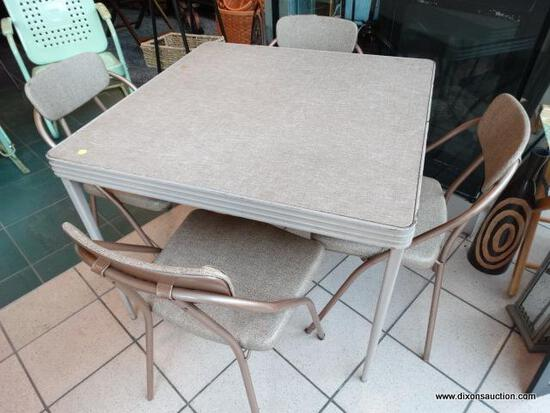 COSTCO 1954 FOLDING CARD TABLE AND FOUR CHAIRS - SOME RUST AND A FEW SMALL TEARS BUT CHAIRS ARE