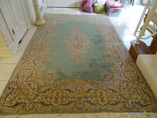 (FOYER) HANDMADE KIRMAN ORIENTAL RUG IN GREEN AND IVORY- 6' X 9', ITEM IS SOLD AS IS WHERE IS