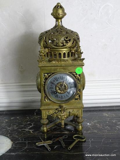 (FOYER) VINTAGE ORNATE BRASS CLOCK WITH 3 KEYS- 5 IN X 5IN X 14 IN ITEM IS SOLD AS IS WHERE IS WITH
