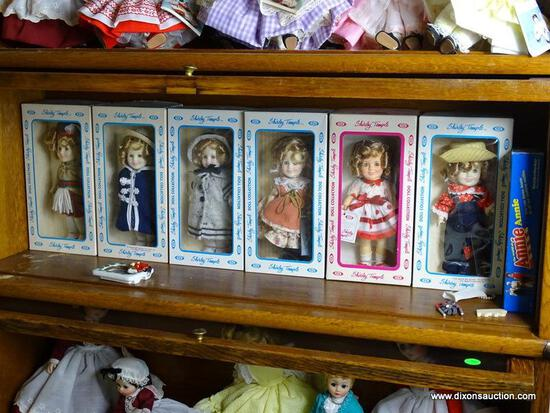 (UPBED 1) SHELF LOT 0F 6 SHIRLEY TEMPLE DOLLS IN ORIGINAL BOXES AND INCLUDES ANNIE DOLL IN BOX- 6 IN
