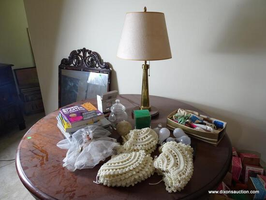 (UPBED 1) CONTENTS ON TOP OF TABLE- BRASS FIRE NOZZLE LAMP- 27 IN H, COMPUTER BOOKS, CROCHETED
