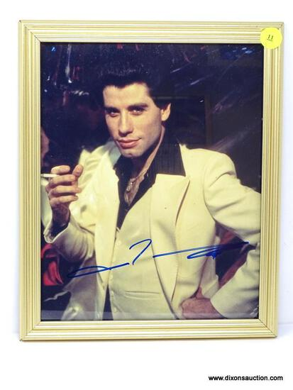 JOHN TRAVOLTA SIGNED PHOTOGRAPH WITH COA. IS IN A GOLD TONE FRAME. MEASURES 9 IN X 11 IN. ITEM IS