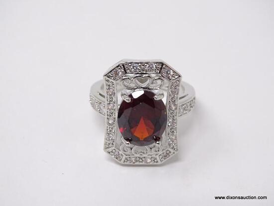 .925 STERLING SILVER LADIES 4 CT GARNET COCKTAIL RING. SIZE 8.