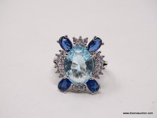 .925 STERLING SILVER LADIES 5 CT BLUE TOPAZ COCKTAIL RING. SIZE 8.