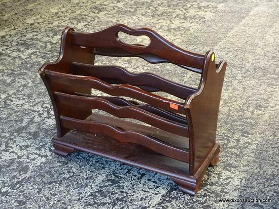 (R1) MAHOGANY MAGAZINE HOLDER WITH CENTER HANDLE. MEASURES 12 IN X 18 IN X 17 IN. ITEM IS SOLD AS