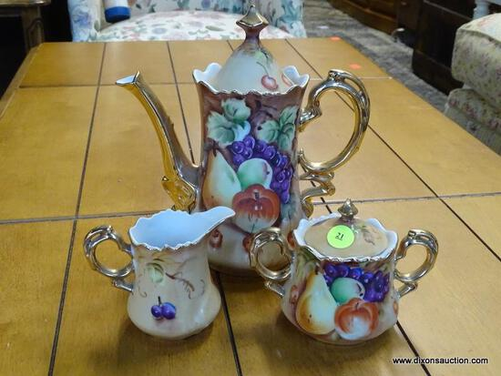 (R1) LEFTON CHINA TEA SET TO INCLUDE A TEA POT, A CREAMER, AND A SUGAR DISH. ALL HAVE A MATCHING