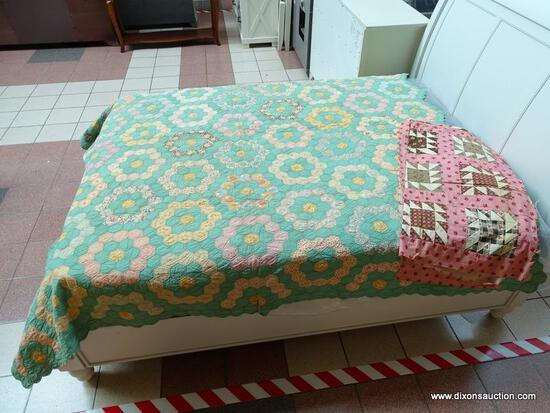 (R1) GEOMETRIC PATTERN QUILT IN HUES OF TURQOUISE, YELLOW AND WHITE. ITEM IS SOLD AS IS WHERE IS