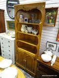 (R1) PINE CORNER CABINET WITH 3 UPPER SHELVES AND 2 LOWER DOORS THAT OPEN TO REVEAL EXTRA SHELVING.