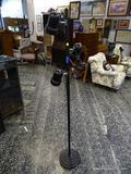 (R1) BLACK 3 LIGHT FLOOR LAMP WITH ADJUSTABLE LIGHTS. MEASURES 64.5 IN TALL. ITEM IS SOLD AS IS