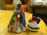 (R1) HANDMADE DOLL WITH A MULTI-COLORED SHAWL AND BLUE, RED, & YELLOW DRESS. MEASURES 10 IN TALL.