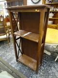 (R1) MAHOGANY FINISH BOOKCASE. HAS 2 ADJUSTABLE SHELVES AND MEASURES 29 1/2 IN X 14 IN X 44 1/2 IN.