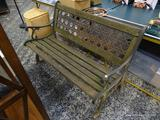 (R1) CAST IRION AND WOOD CONSTRUCTED PARK STYLE BENCH. MEASURES 50 IN X 25 IN X 33 IN. ITEM IS SOLD